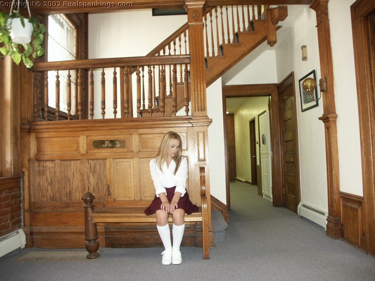 A naughty schoolgirl waits to see the Dean.
