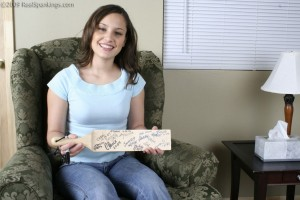 Our model Raquel, proud to have signed our paddle.